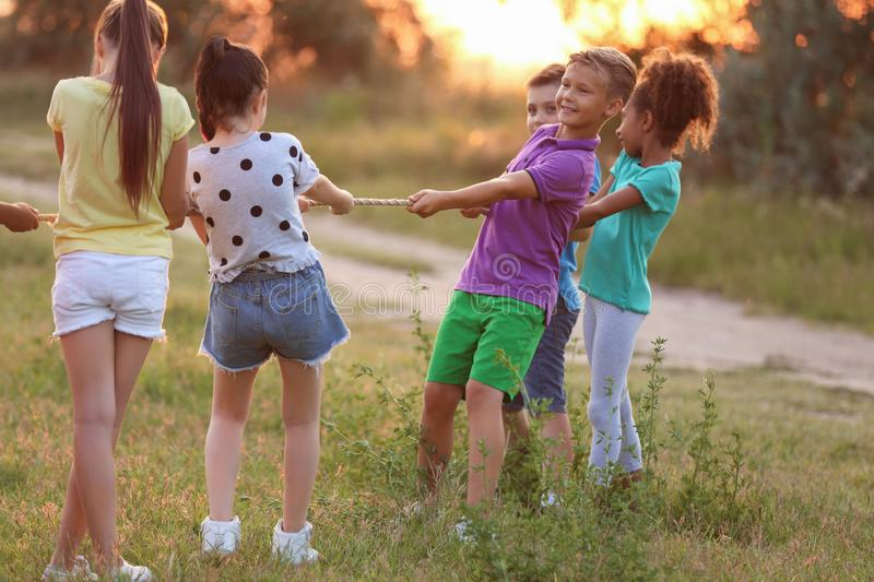 Cute little children playing outdoors stock images