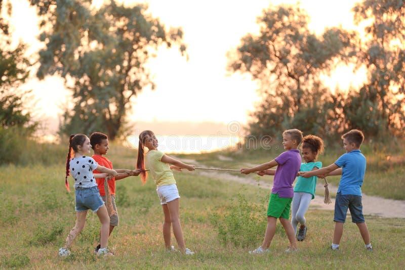 Cute little children playing outdoors stock photos