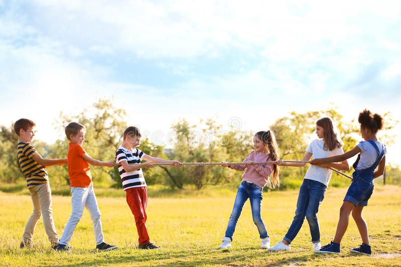 Cute little children playing with rope outdoors royalty free stock photography