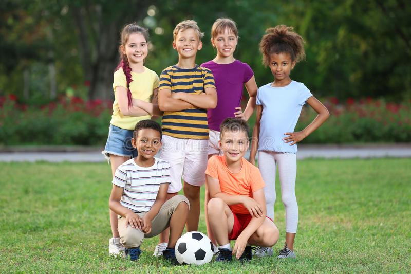 Cute little children with soccer ball. Outdoor play. Cute little children with soccer ball in park. Outdoor play stock photos