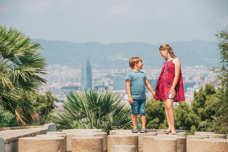 Cute little children tourists admiring Barcelona city. From Montjuic hill, travel with kids royalty free stock image