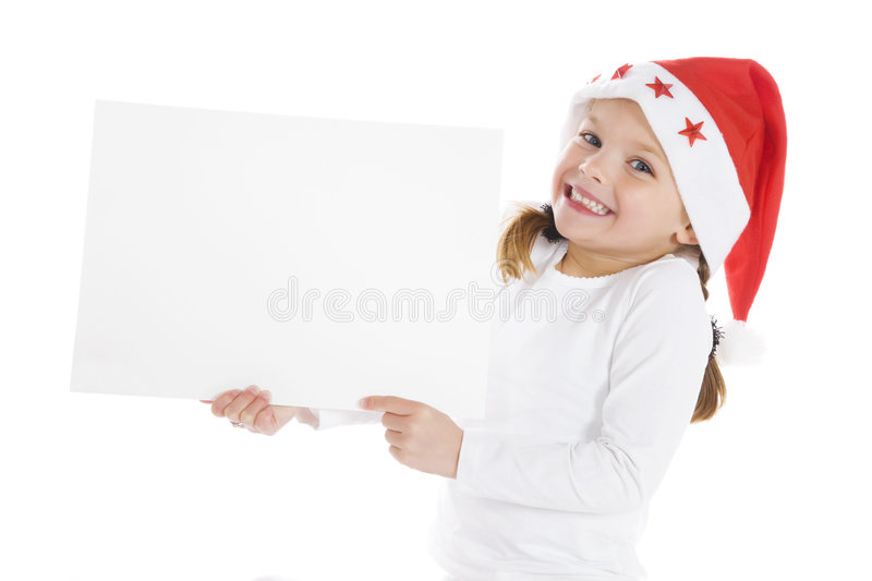 Cute little christmas girl with a blank sign stock photography