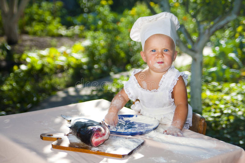 Download Cute little cook stock photo. Image of flour, stand, looks - 20865406
