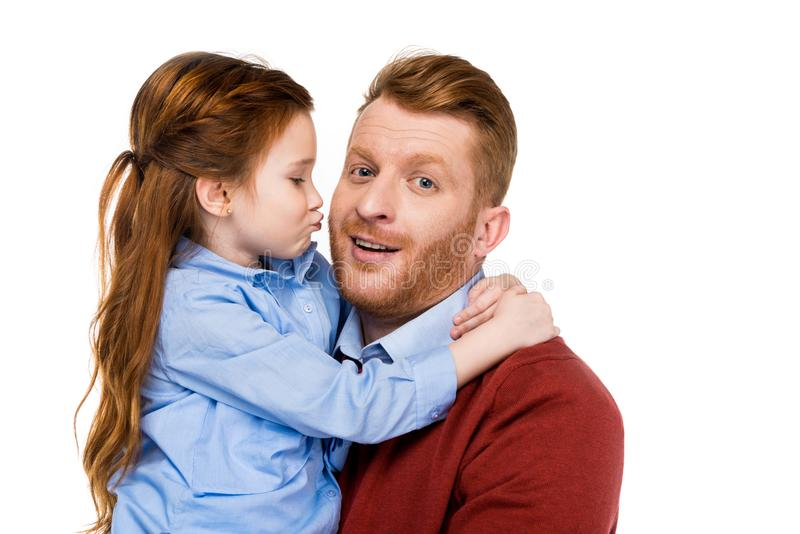 Cute little daughter hugging and kissing happy father. Isolated on white stock photos