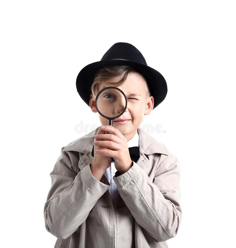 Cute little detective with magnifying glass on white background royalty free stock photos