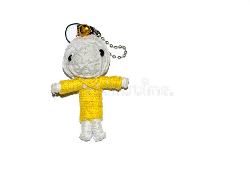 Cute little doll isolated on white background.. Charm keychain for a children bag. Kids sewing crafts idea. Cute little doll isolated on white background. Charm stock images