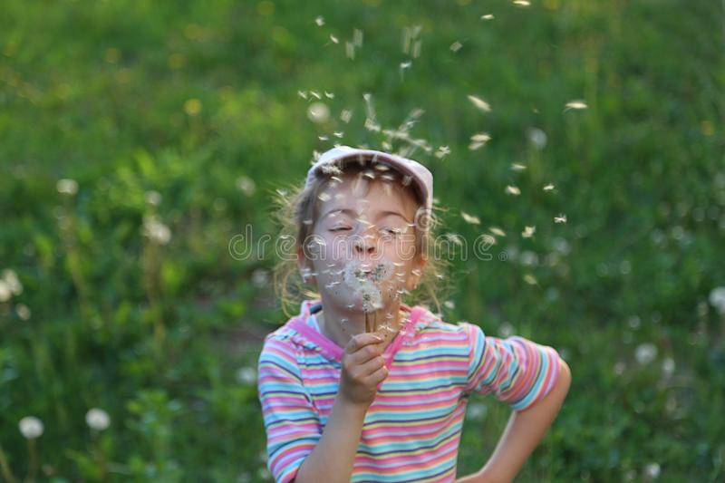 Cute little fashionista girl in warm green summer royalty free stock images