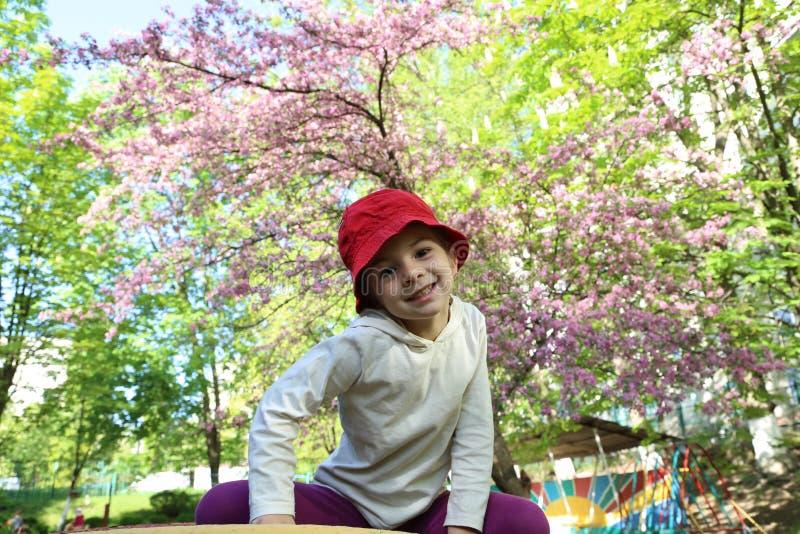 Cute little fashionista girl in warm green summer stock photo