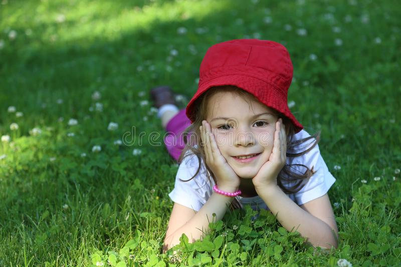 Cute little fashionista girl in warm green summer royalty free stock image