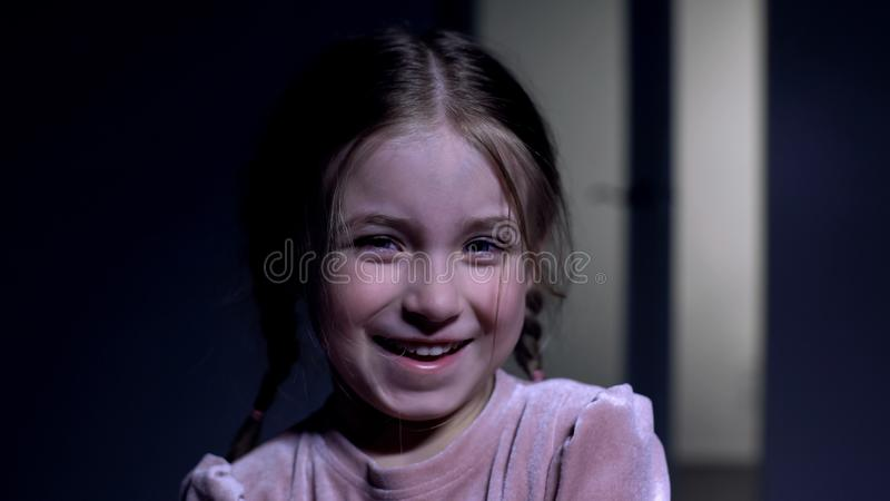 Cute little female kid laughing on camera, sincere childish emotions, close-up stock photo