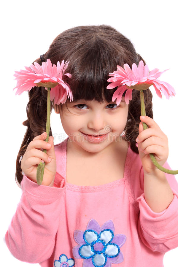 Cute little four year old girl with daisies royalty free stock photo
