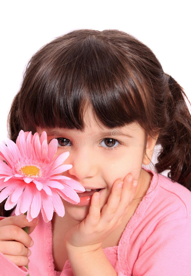 Cute little four year old girl with daisy stock photo