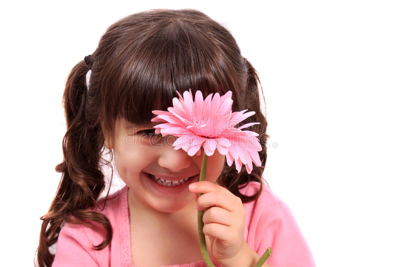 Cute little four year old girl with daisy stock photos