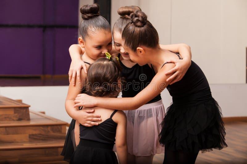 Cute little friends in dance class. Pretty little Hispanic friends having fun during a ballet class in a dance academy stock images