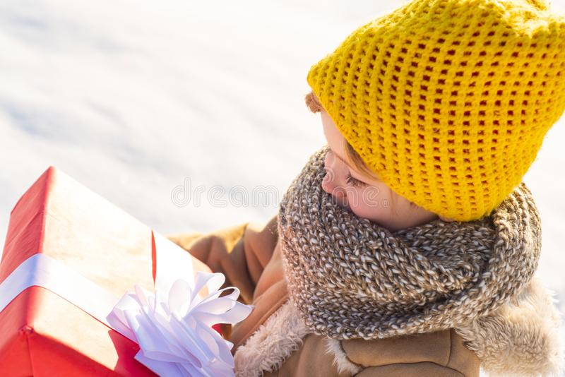 Cute little funny child in colorful winter clothes having fun with snow outdoors. Cute little boy kid in winter clothes stock photos