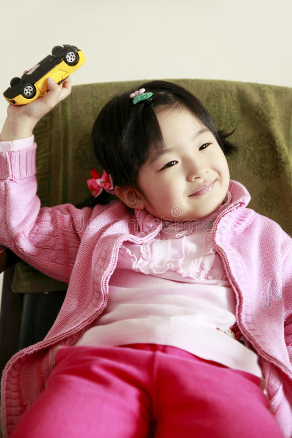 Download Cute little girl stock photo. Image of green, asia, little - 13027920