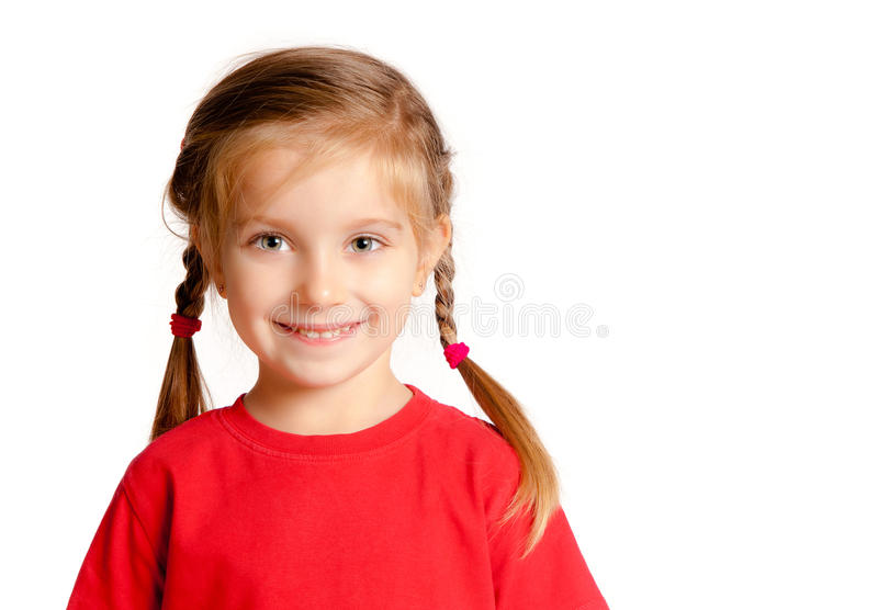 Cute little girl. Smiling on a white background stock image