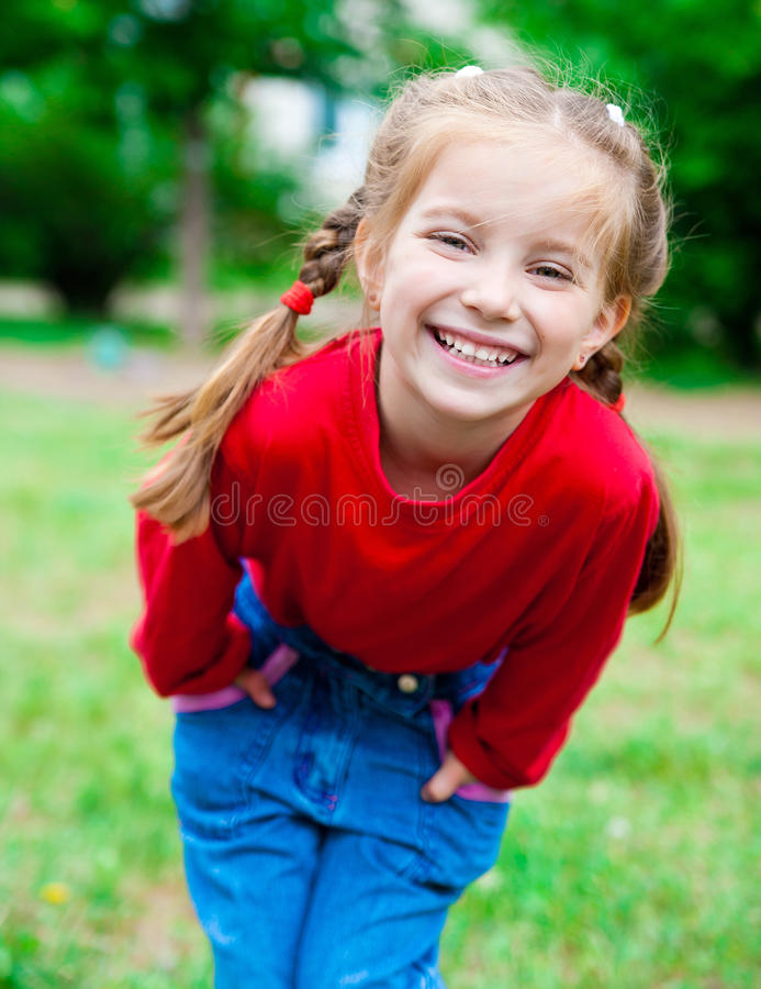 Download Cute little girl stock image. Image of smile, grass, happy - 24877745