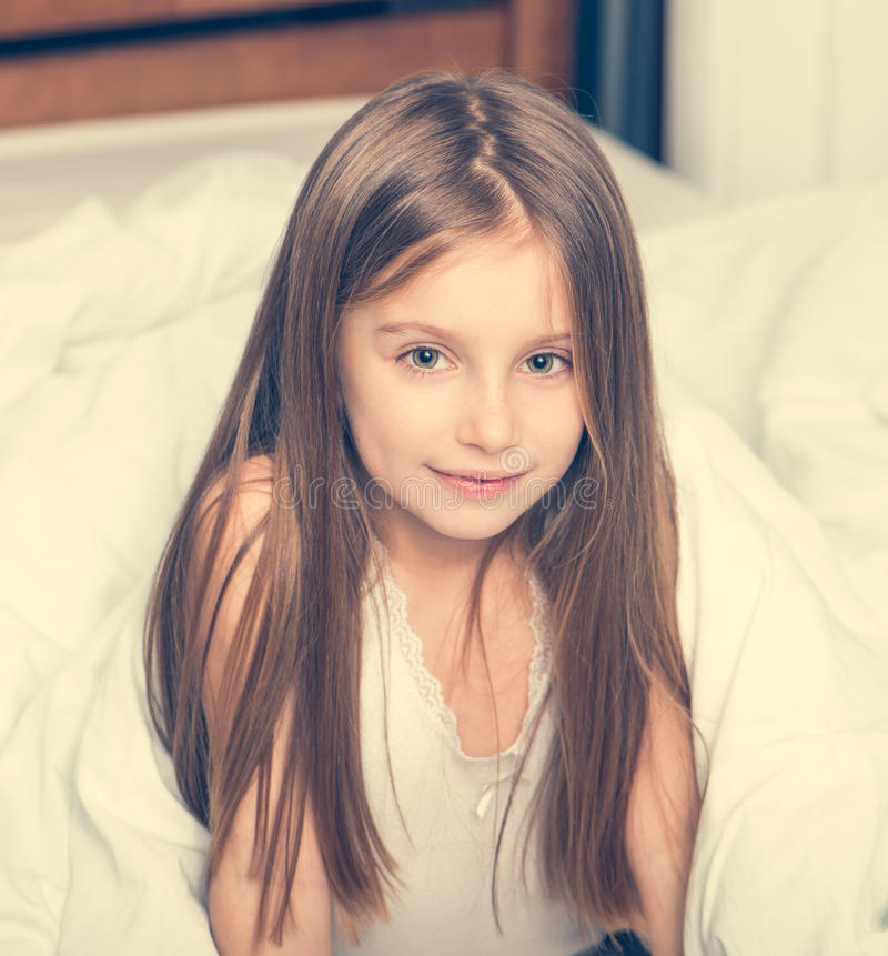 Cute little girl in a bad stock photo