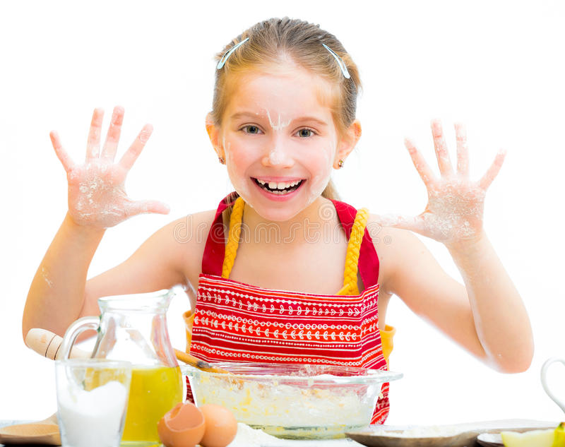 Cute little girl baking on kitchen. And shows hands isolated on a white background stock image