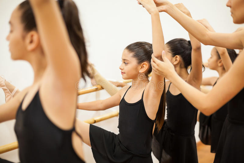Cute little girl in a ballet class stock photo