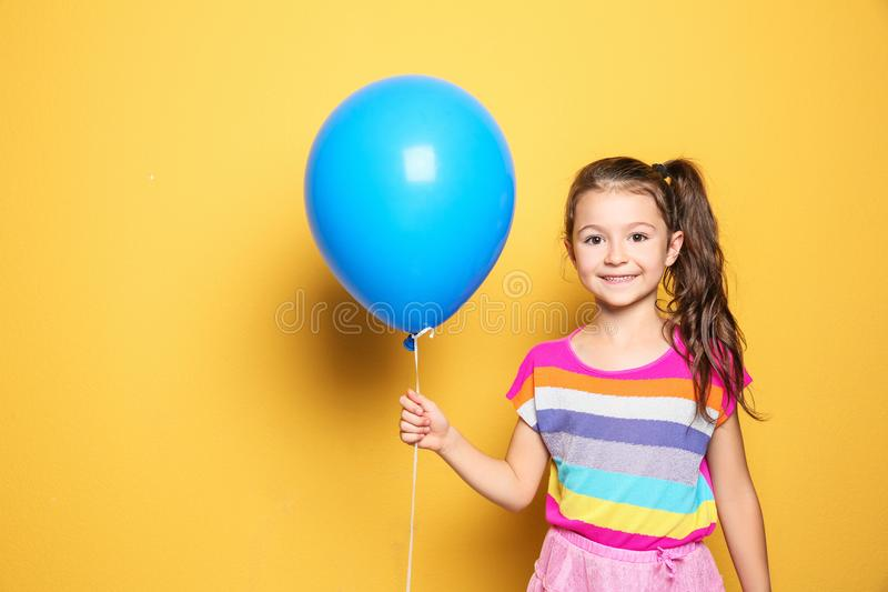 Cute girl with balloon on color background. Birthday celebration. Cute little girl with balloon on color background. Birthday celebration stock image