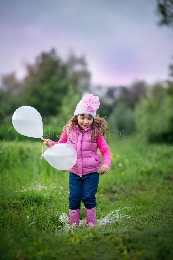 Cute little girl with balloons stock photography