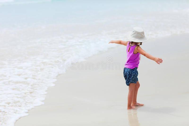 Download Cute little girl at beach stock image. Image of sand - 28944993