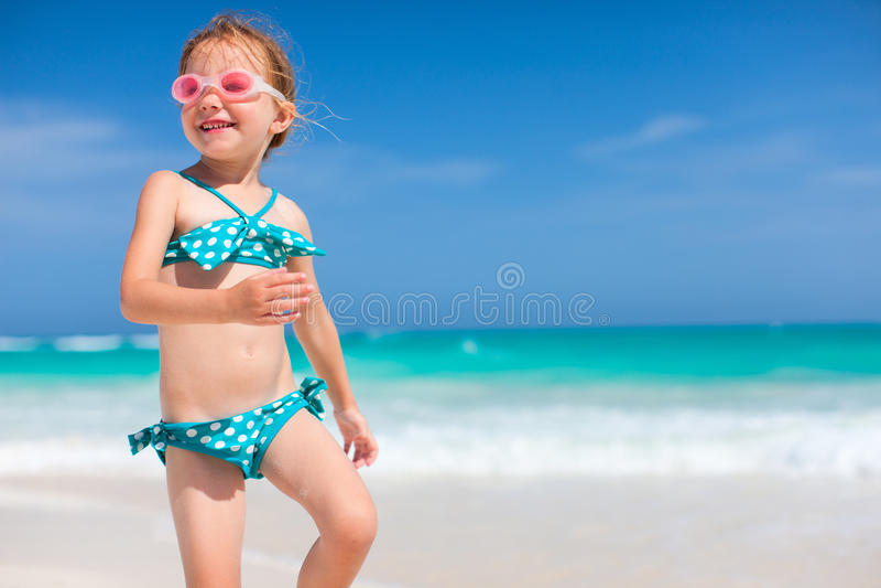 Cute little girl at beach royalty free stock photos