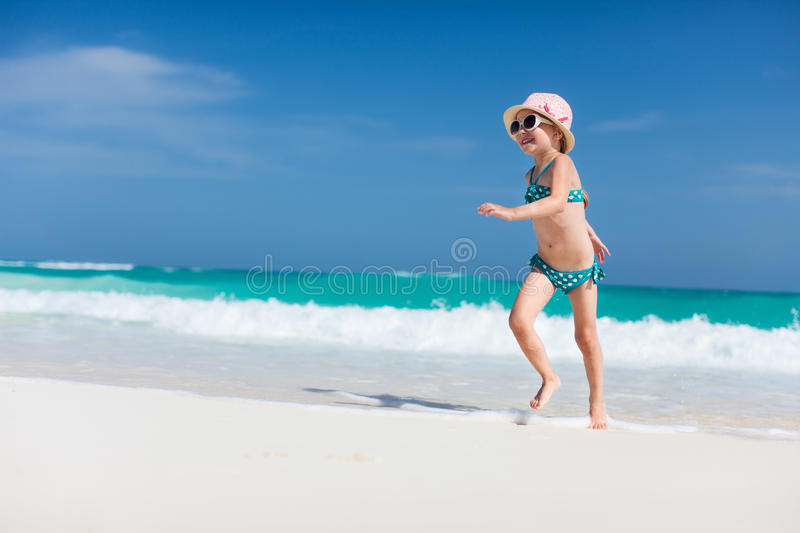 Download Cute little girl at beach stock photo. Image of beautiful - 34023418