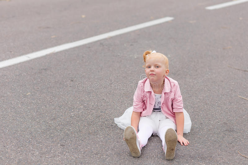 Download A Cute Little Girl In A Beautiful Dress And Sneakers Playing On Stock Photo - Image: 83719653