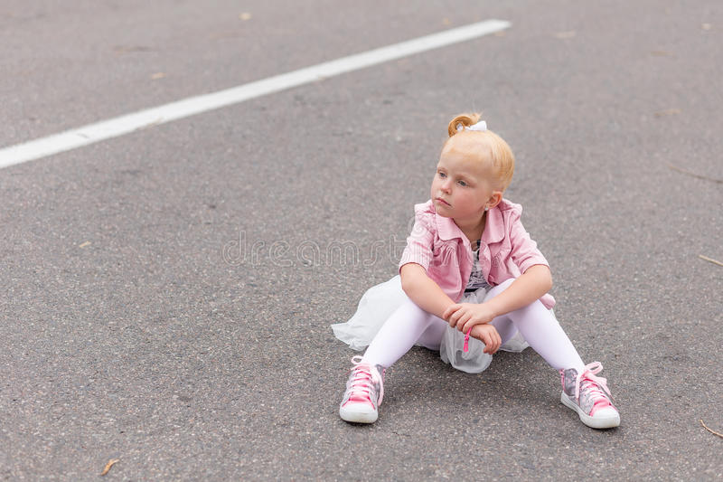 Download A Cute Little Girl In A Beautiful Dress And Sneakers Playing On Stock Image - Image of fashion, child: 83720139