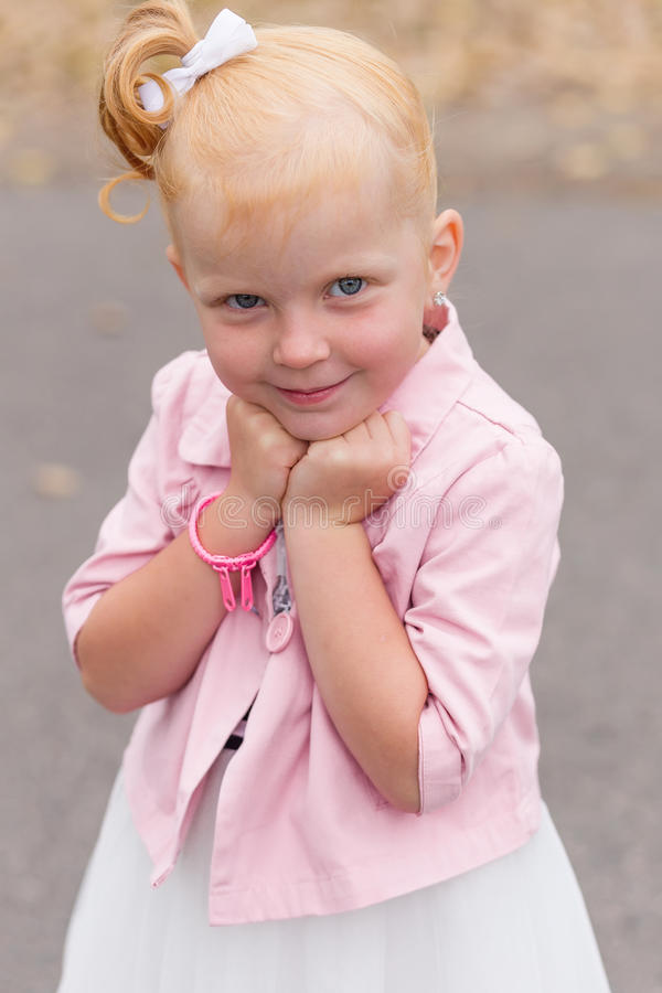 Download A Cute Little Girl In A Beautiful Dress And Sneakers Playing On Stock Image - Image: 83720625