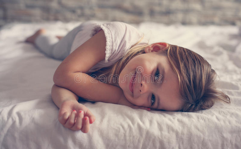 Cute little girl in bed. royalty free stock photos