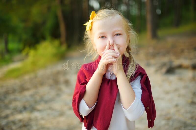 Cute little girl being silly and making funny faces stock photo
