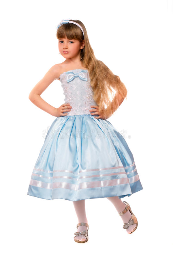 Cute little girl in a blue dress stock photos