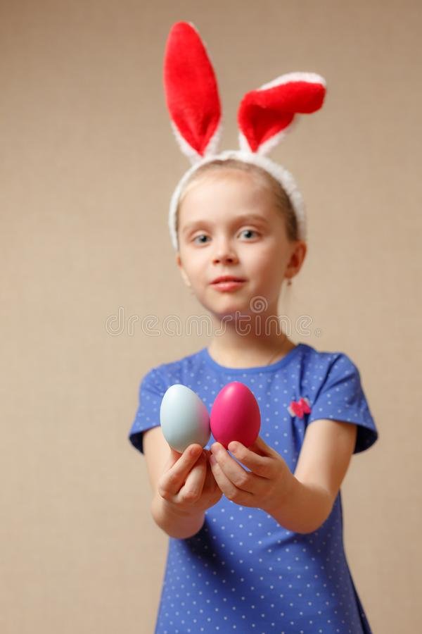 Cute little girl with bunny ears and Easter eggs. selective focus royalty free stock images