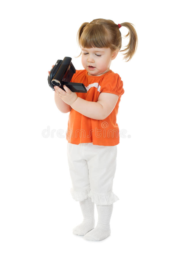 Cute little girl with camcoder royalty free stock photo