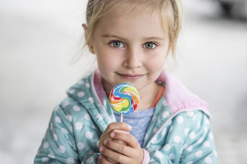 Cute little girl with candy stock photography