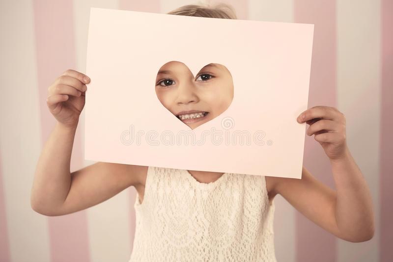 Cute little girl. Little girl with card for Valentine's day stock photos
