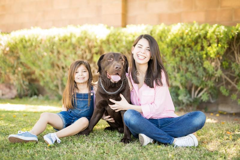 Sweet girl and woman with doggy royalty free stock images