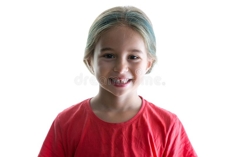 Cute little girl with a cheerful playful grin stock photo