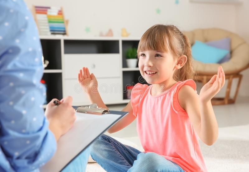 Cute little girl at child office. Cute little girl at child psychologist`s office royalty free stock image