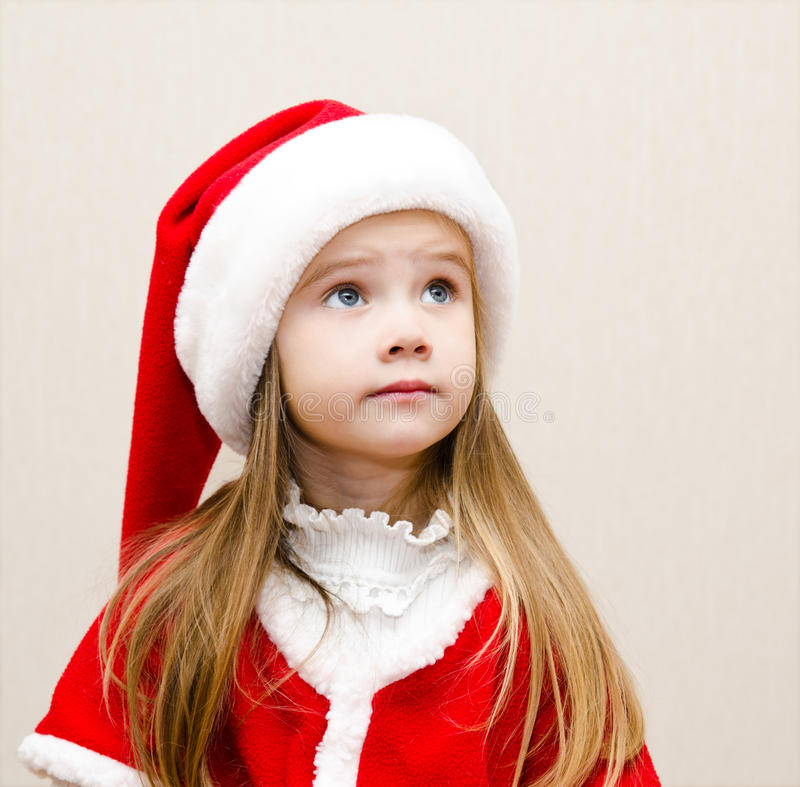 Download Cute Little Girl In Christmas Hat Dreaming And Looking Up Stock Image - Image: 34414665