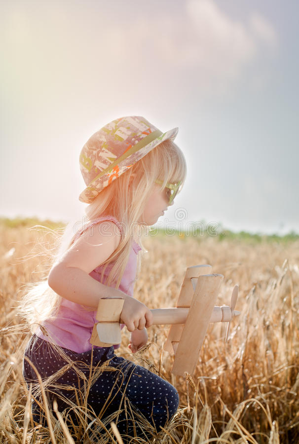 Cute little girl in a colorful hat and sunglasses stock image