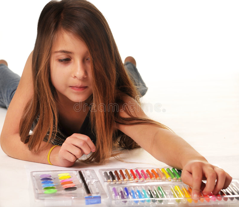 Cute little girl coloring royalty free stock image