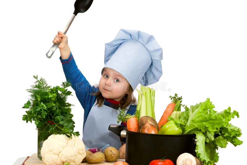 Cute little girl cooking soup. With lots of different vegetables. Isolated stock photo