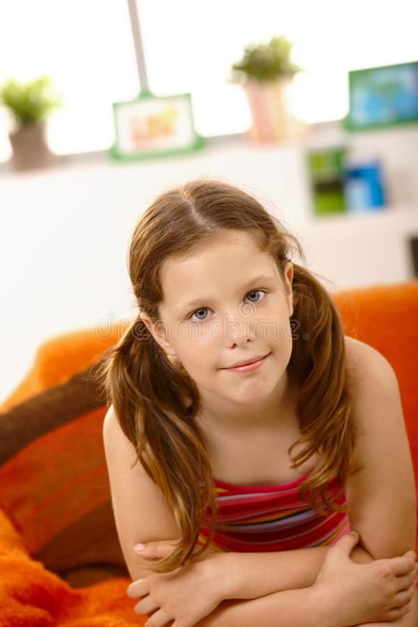Cute little girl on couch stock photography