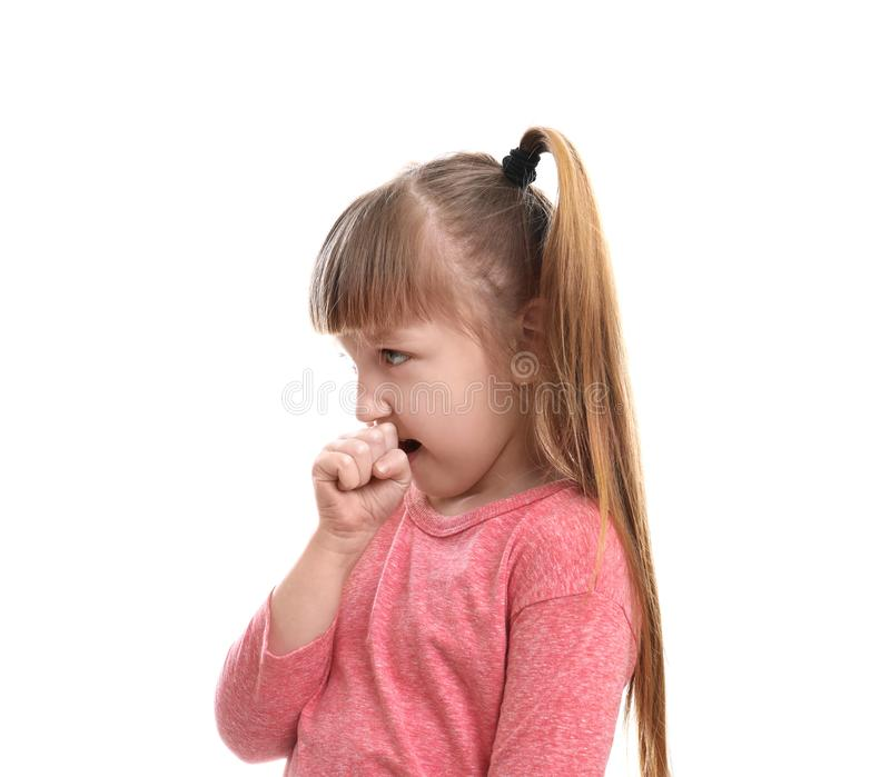 Cute little girl coughing against. White background stock photography