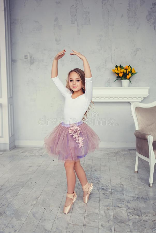 A cute little girl is dancing like a ballerina royalty free stock photos